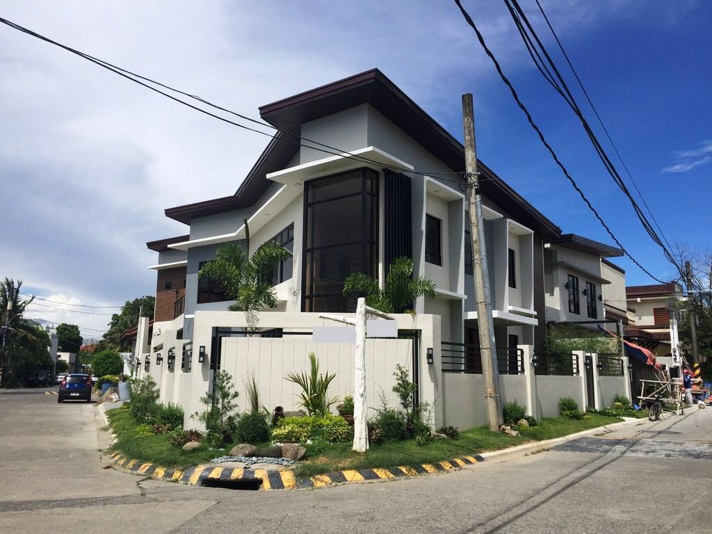 Corner lot house design philippines home design 2017 for Modern house design corner lot